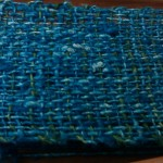 Closeup of the weave.  It should settle a good bit once it's washed and blocked.